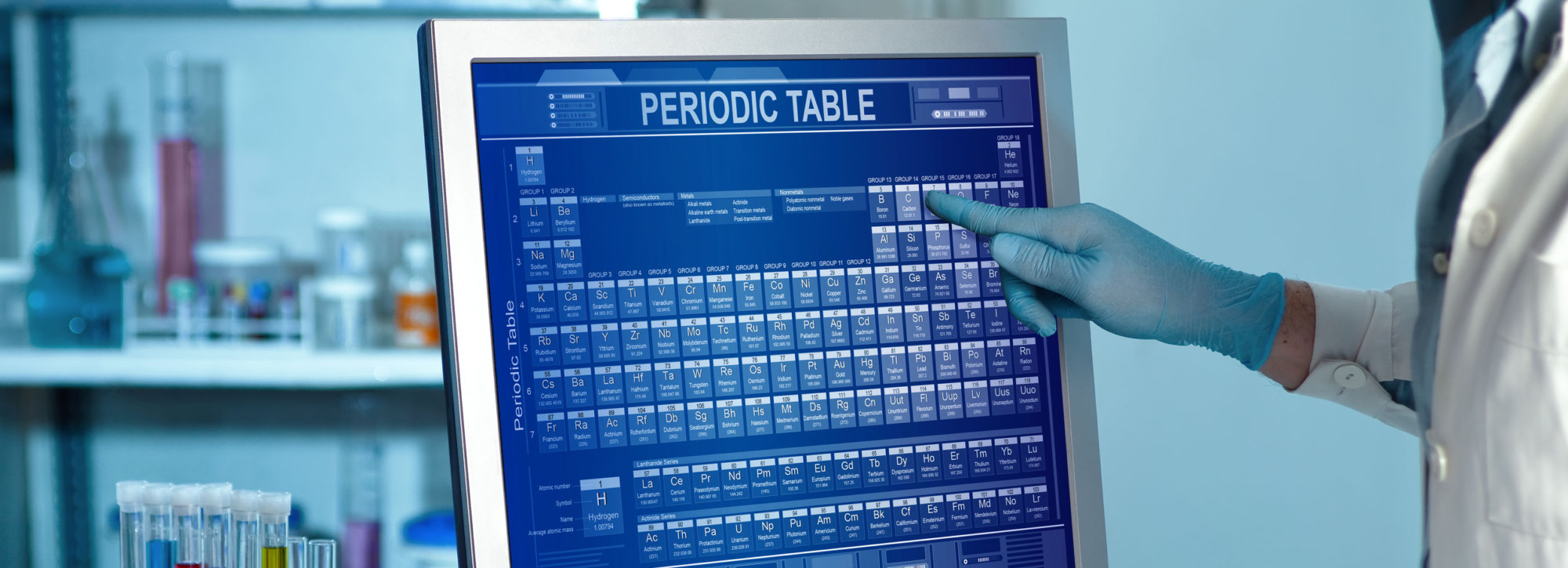 Scientific Working In Lab And Touching A Screen With The Periodi